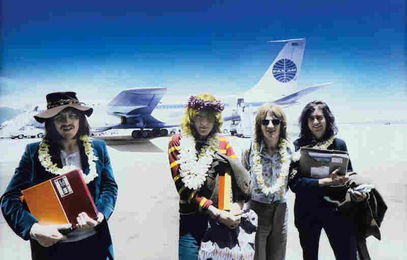 Led Zeppelin arriving in Honolulu, 1969, carrying master tapes for the album Led Zeppelin II.