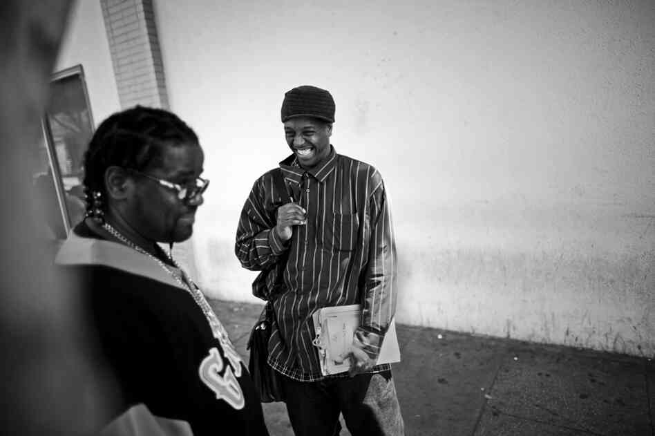 General Jeff jokes with a friend on San Pedro Street, in the heart of Skid Row.