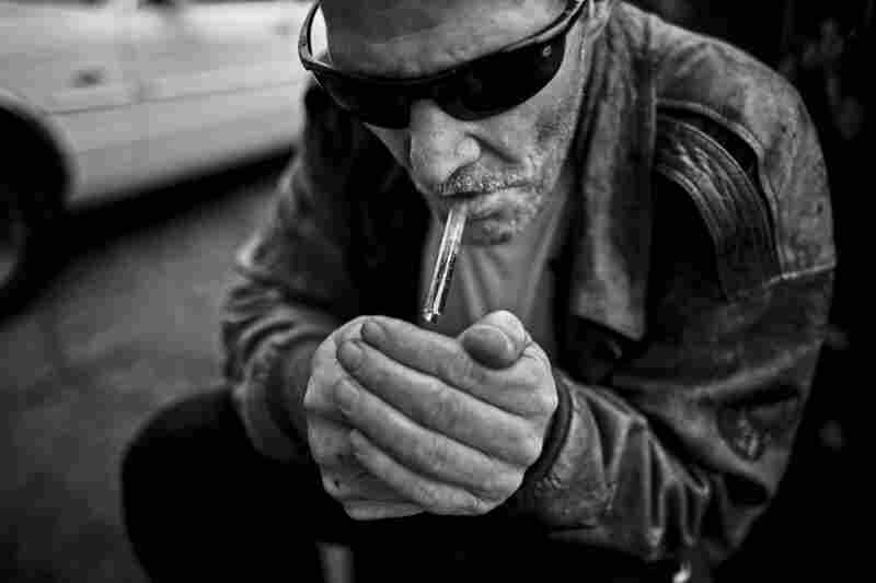 "A man who goes by the name Paul smokes crack on 7th Street.  Paul said this is his first hit in 150 days. He moved away from ""The Row"" to avoid temptation, but laments that it ultimately dragged him back."