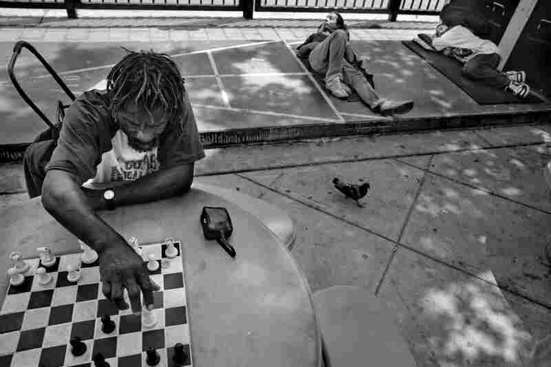 Willie Brown, 55, who has been living on Skid Row for the last 25 years, plays chess with a friend in Gladys Park.