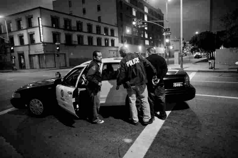 A young man is arrested on the corner of 5th and San Pedro streets, across from the prayer service.