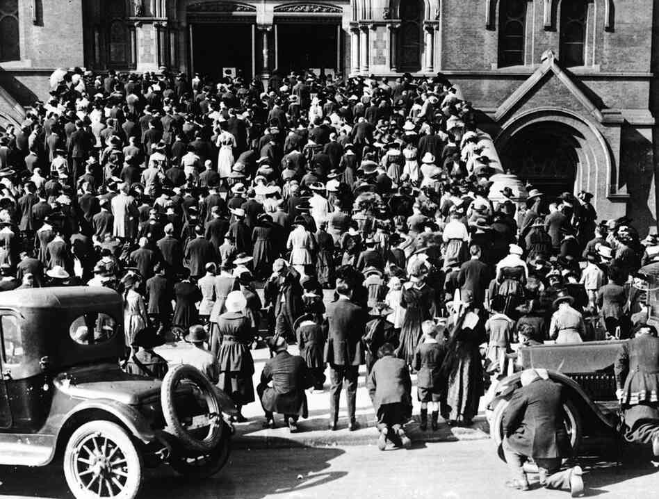 During the 1918 flu pandemic, prayers were issued on the steps of the Holy Cross Church in Fresno, Calif., to ward off the virus.