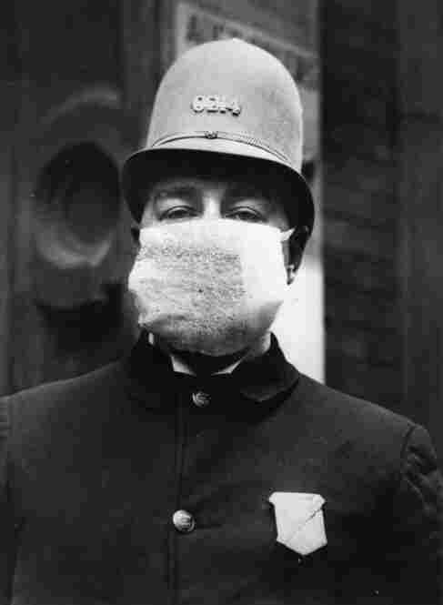 The flu mask, sported here by an American policeman, was worn for protection against the outbreak of the Spanish flu following World War I. It is still used today.