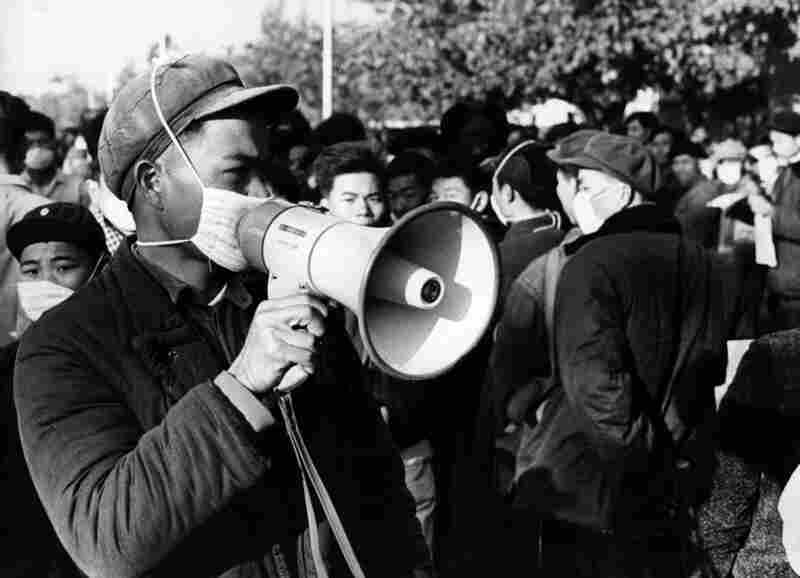 In 1967, Chinese Red Guards wear anti-flu masks as ordered by Chairman Mao Zedong during the Cultural Revolution. The reach of influenza is both global and timeless and, at least for now, completely unpredictable.