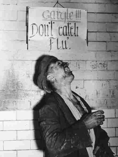 Years later, in the late 1930s, gargling was still the best solution — even overseas.  In England, a miner has an anti-flu gargle after work, heeding the notice above.