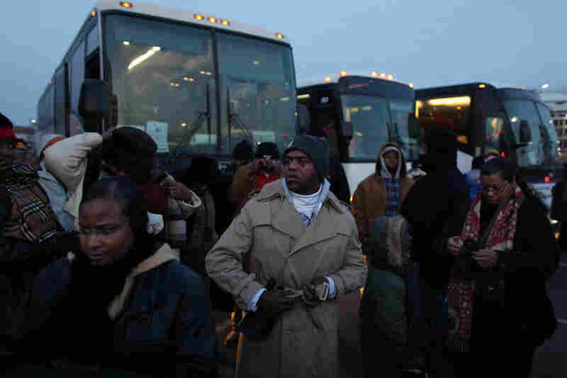 Parishioners from the Greater Imani Church in Memphis, Tenn., step off tour buses after a long journey to attend Obama's inauguration.