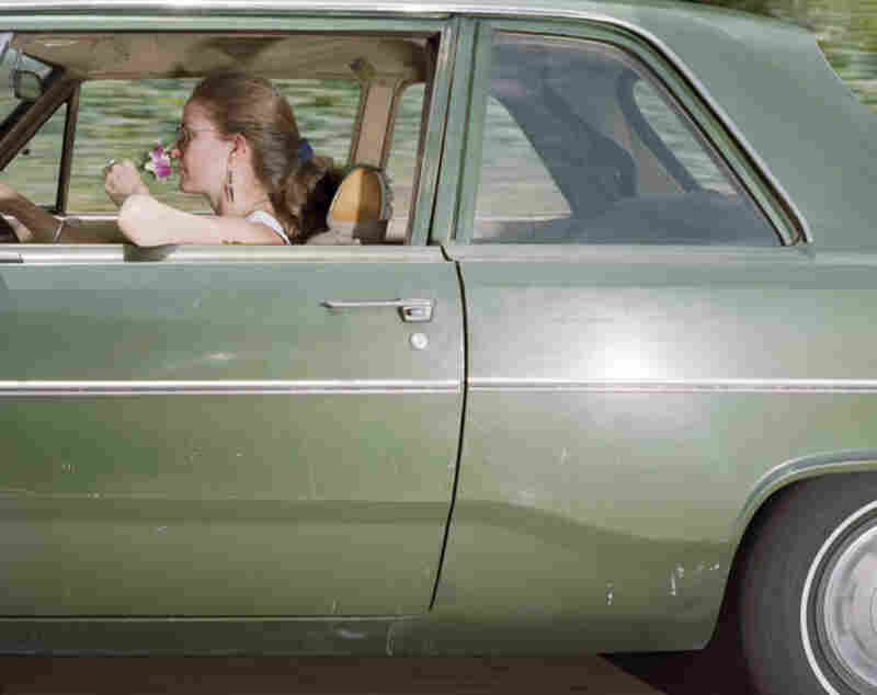 Woman cruising south at 63 mph on the Hollywood Freeway in Los Angeles on a Saturday afternoon in 1991