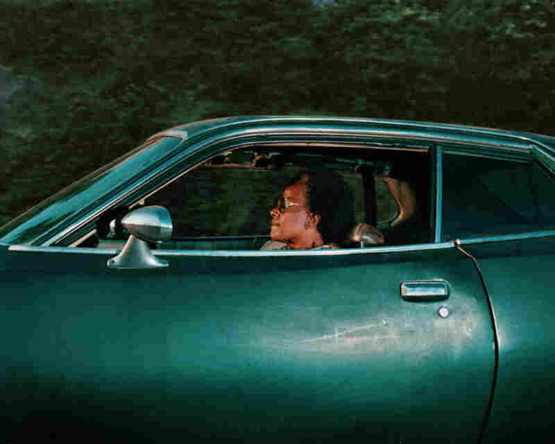 Person driving somewhere in the 1990s