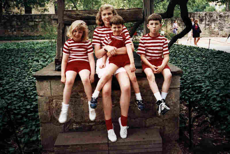 Alyson Hurt, graphics designer, Digital Media:  Where's Waldo? My mom had four kids, and when we were younger she'd dress us all alike so she could find us in crowds. This photo is circa 1992 at the Alamo in San Antonio. From left: Ashley, Alyson, Ross and Ryan.