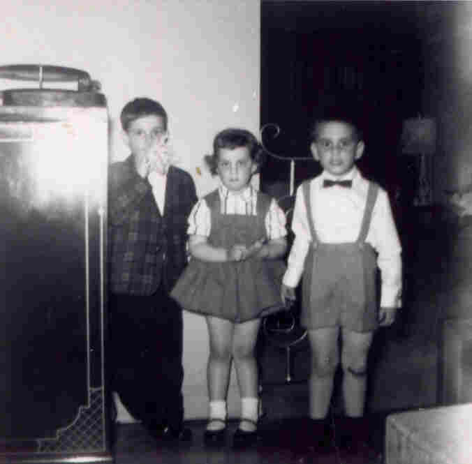 Bob Boilen, producer, Music: What can I say; my mom liked to play dress-up and I guess I was her doll. I don't remember this day or how those shorts got such a perfect crease. I do know that to this day I'm still never far from a turntable (see left side of photo).