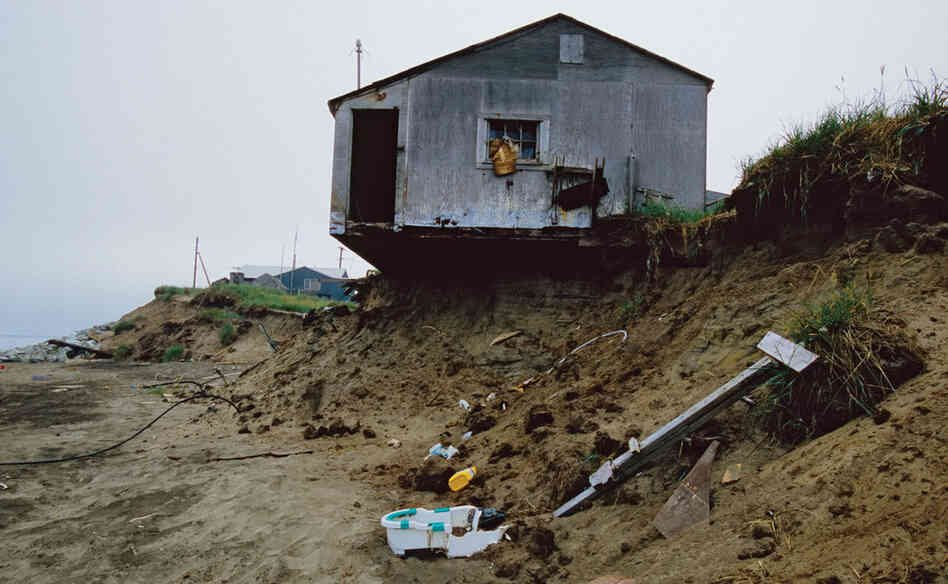 Arctic soils are generally held together by ice and permafrost.  As the permafrost melts, the soils become very sandy and easy to erode.  At the town of Shishmaref on the Bering Strait, coastal erosion rates can reach more than 60 feet a year.