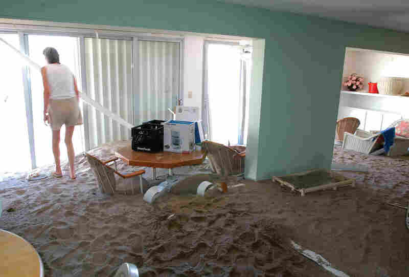 Extreme weather can be tied to climate change.  This image shows a sand flood in a beach home on the east coast of Florida after storm surges associated with hurricanes Jeanne and Frances.