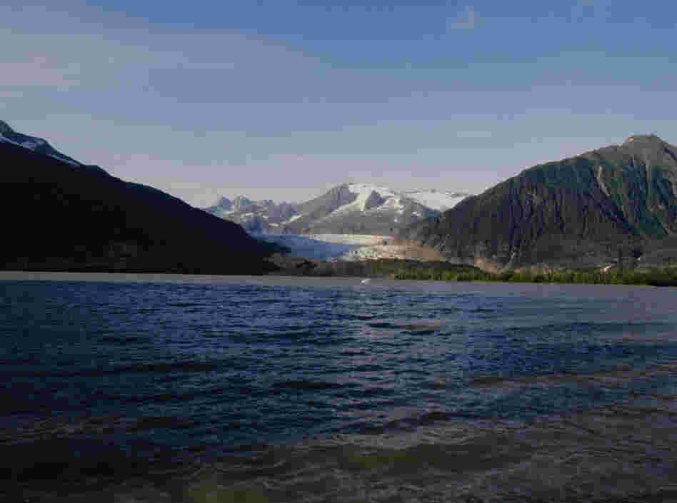 The Mendenhall Glacier, photographed again in 2004. As with almost all Alaskan glaciers, and indeed most glaciers globally, the front has retreated dramatically because of warmer temperatures during summer and reduced snowfall in winter.