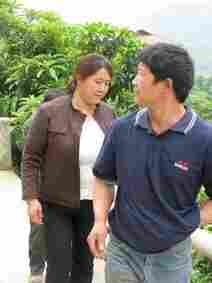 Chen Yan and her husband take us up the mountain past their plum trees.