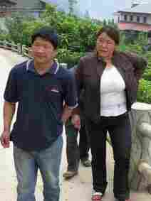 Chen Yan and her husband take us up the mountain path that leads through Stone Chair Village.