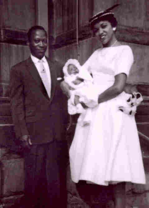 Keith Jenkins, senior supervising producer, Multimedia: Mario Powlis (my uncle and godfather), me and Dannetta Black (my godmother) at my christening at the Church of St. Augustine, in the Bronx, N.Y., 1957.  Photo by Warren B. Jenkins