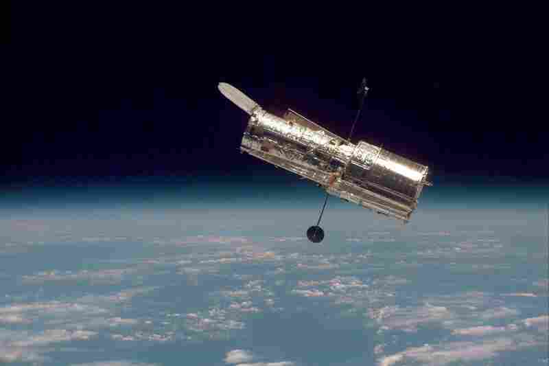 The Hubble Space Telescope hovers at the boundary of Earth and space in this picture, taken after Hubble's second servicing mission in 1997.