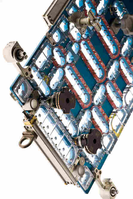In order to access the failed STIS electronics card, astronauts must remove 111 screws, which could simply float away during the task. So the STIS fastener capture plate fits over the electronics cavity cover plate and catches each screw as it's removed.