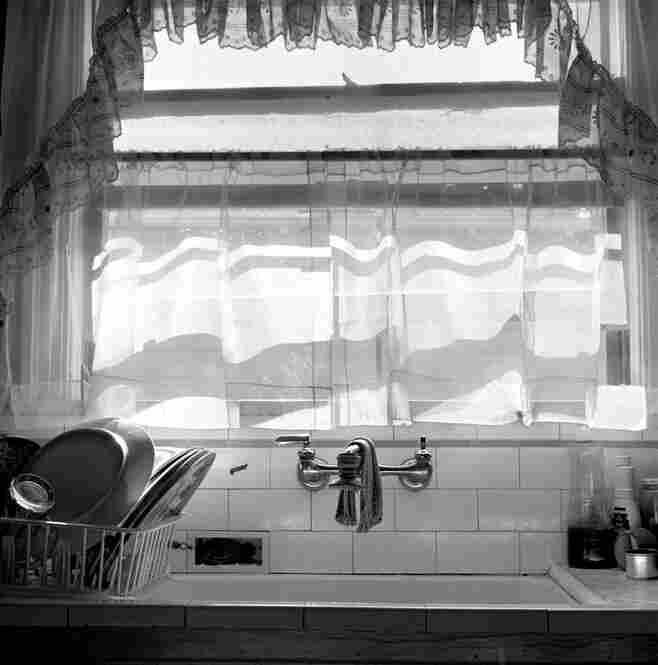 Lupe's kitchen, 1970s.  Quiet domestic scenes recur in Leonard's book.