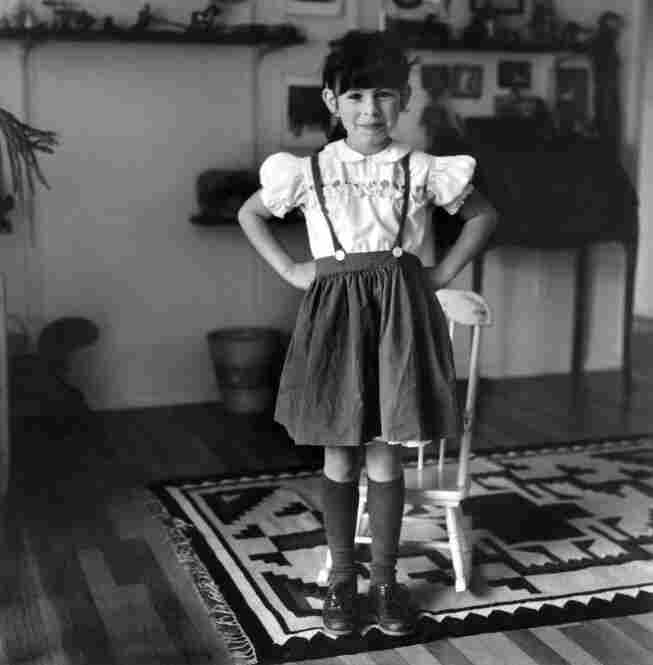 Julia with hands on hips, circa 1982.  Leonard's portfolio is also largely a reflection on what it has meant to be a single mother from the 1970s onward.