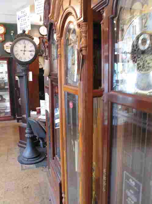 The view from Yakov's desk.  Most of these grandfather clocks are new and years away from needing his expertise.
