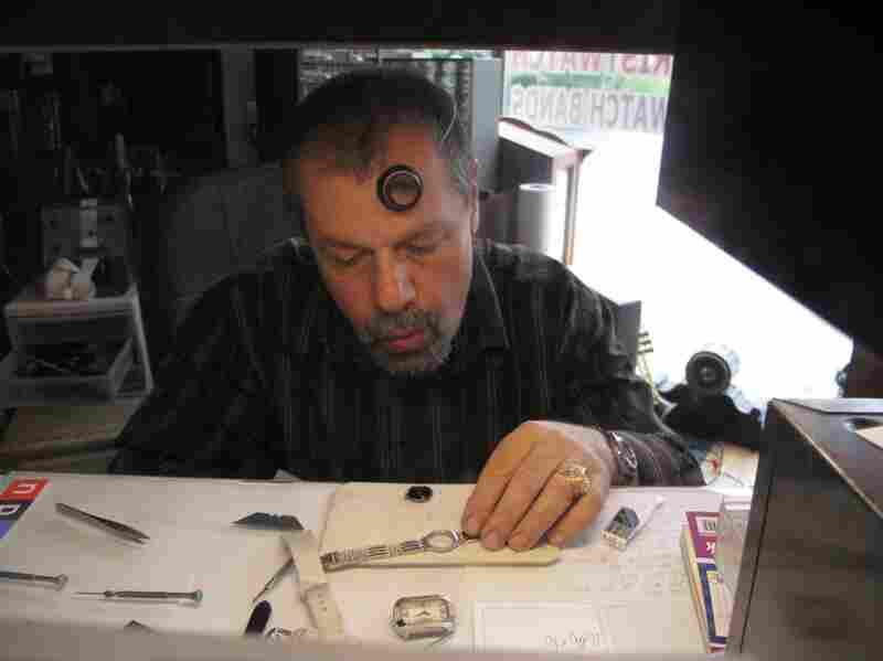 Watchmaker Yakov at work refurbishing a wristwatch.