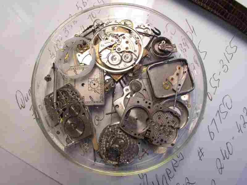 A petri dish of watch parts, always close at hand.
