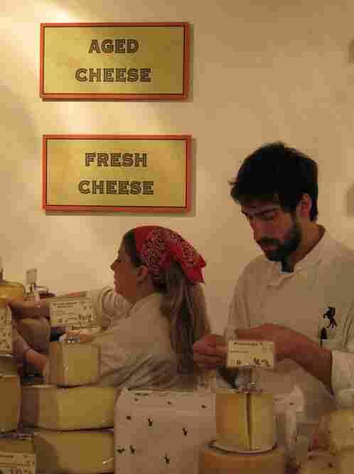 Cheese mongers Genina Black and Nathan Mancini prepare for the rush.