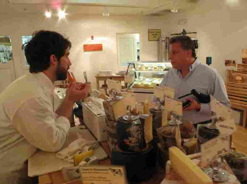 Mancini helps Arthur Axelson select a cheese tray.