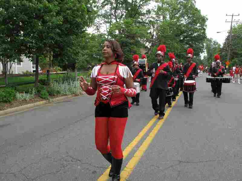 Director Corlis Greene leads the band. She's 52, and first marched as a Westsider at age 8.