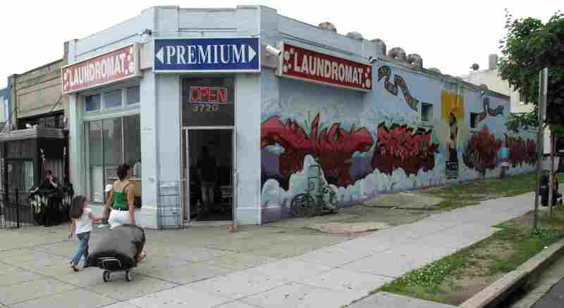 The corner of 14th and Quincy Street, NW in D.C.'s Columbia Heights neighborhood. The owner of this laundromat got tired of the street gangs tagging his building. He asked a local crew graffiti artists to fight back with an artistic mural.