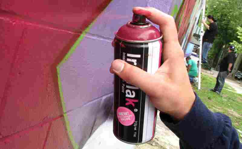 """Graffiti artists say creating a masterpiece includes carefully spraypainting outlines and """"fades,"""" or shadows."""
