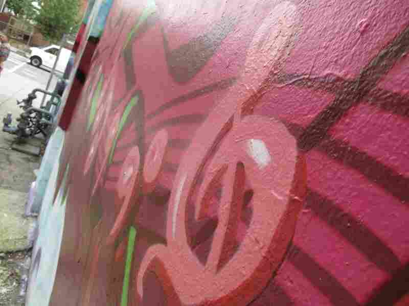 """This graffiti mural is dedicated to a local D.J. named """"Menace."""""""