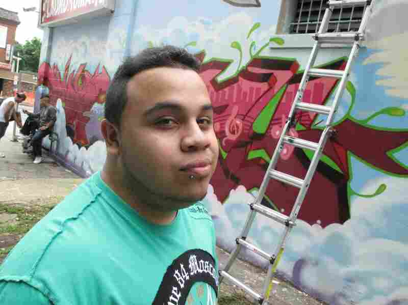Joshua Vasquez says he and the crew had to repaint the mural after the police ordered the first one whitewashed. He hopes the local street gangs don't tag over this one.
