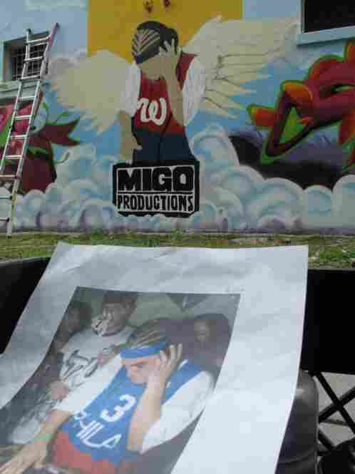"""This graffiti mural is dedicated to a popular local D.J. who went by the name """"Menace."""" After he died in a car accident earlier this year, hIs homeboys at Migo Productions comissioned the mural in his honor."""