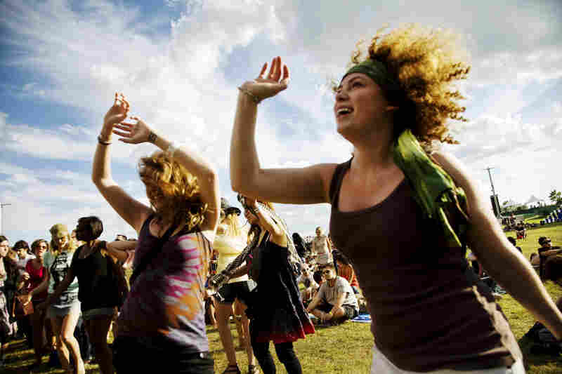 Young women dance to the sounds of the band Animal Collective at the three-day concert held at Liberty State Park in New Jersey.