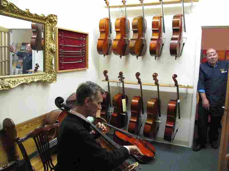 Lewis Roberts is a cello sales associate. Bill Weaver (right) is from the Violin House of Weaver, right next door.