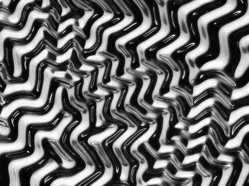 "Add water to a thin layer of gel on the surface of an elastic polymer and you get a ""polymaze."" This image was made with an ordinary light microscope and is not manipulated or artificially colored."