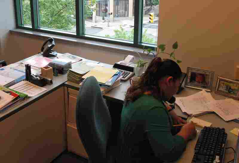 Deiry Trejo works in the administrative office of Arlington Public Schools, overlooking the intersection of Clarendon Boulevard and N. Edgewood Streets.