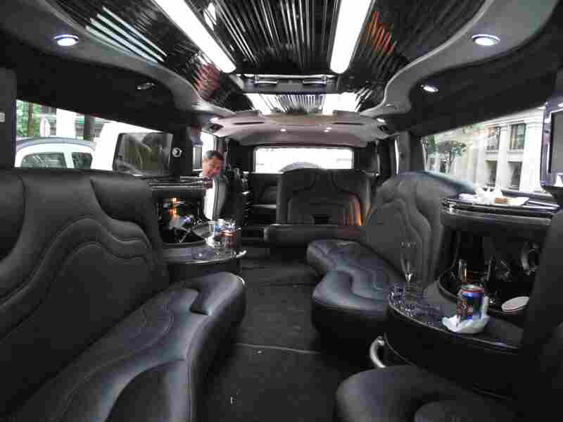 Marco Gongora owns Atlantic Limousine Service.  Tonight he's waiting for a wedding party to finish dinner at Cafe Atlantico.  His 22-passenger H2Hummer limousine costs $245 an hour.