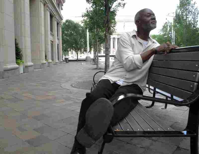 """DC-native John DuVall comes to the Navy Memorial park to listen to the water. He says it's cheaper than visiting """"the islands."""""""