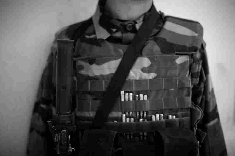 An Afghan commando gears up with bullets stuffed in his flak jacket. An average Afghan soldier may shoot 200 rounds from his AK-47, but the commandos shoot up to 7,000 rounds.