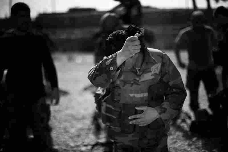A commando wipes away the sweat during a training session.