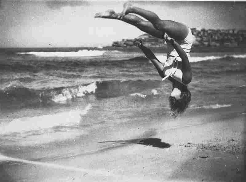 Peggy Bacon in midair back flip, Bondi Beach, Sydney, Australia, 1937.