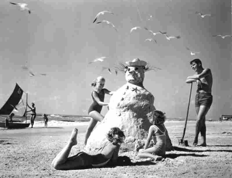 "Three Girls Making a ""Sandman"" At The Beach, 1964."