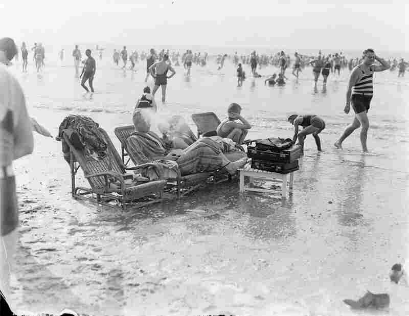 In this undated photo, a Dutch family sets up chairs in the incoming tide.
