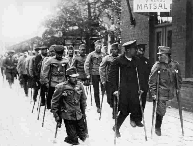 Disabled German and Austrian servicemen released from captivity in Russia gather at Hallsberg station for a prisoner-of-war exchange under the auspices of the Swedish Red Cross, World War I.