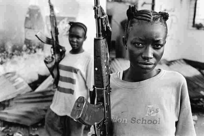 Female government fighters in Ganta, Liberia, near the border with Guinea, 2003.