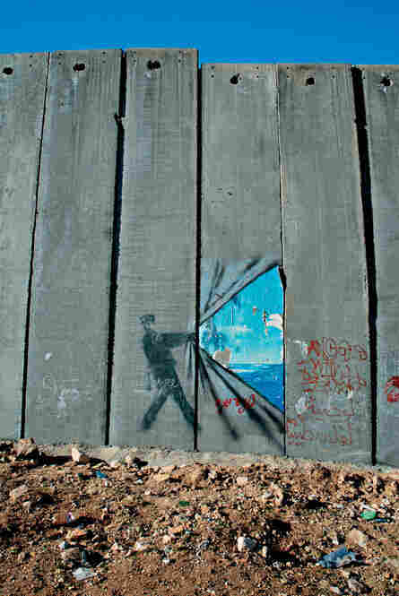 Graffiti on the West Bank barrier that divides Israel from its occupied Palestinian territories, 2007.