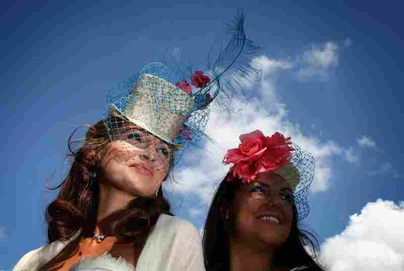 Tanaz Dizanii (left) and friend wearing veiled hats on the first day of Royal Ascot 2009.